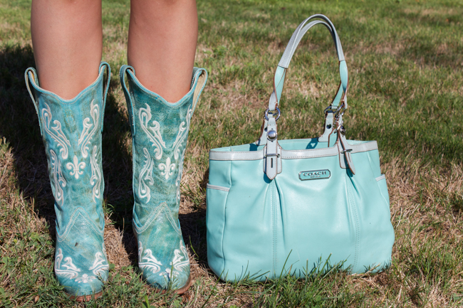 Corral turquoise cowboy boots with snip toes and a Coach bag